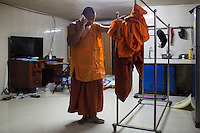 February 04, 2014 - Phnom Penh, Cambodia. Venerable Loun Sovath on the phone in his room in Samaky Raingsey Pagoda. © Nicolas Axelrod / Ruom