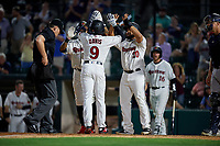 Rochester Red Wings Jaylin Davis (9) high fives Jordany Valdespin (23) and Wilin Rosario (20) after hitting a home run during an International League game against the Scranton/Wilkes-Barre RailRiders on June 24, 2019 at Frontier Field in Rochester, New York.  Rochester defeated Scranton 8-6.  (Mike Janes/Four Seam Images)