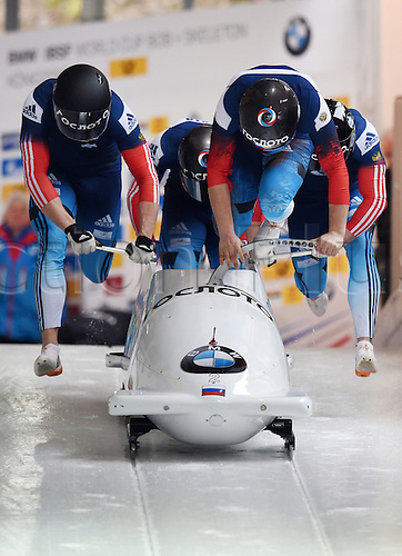 28.02.2016. Koenigssee, Germany.  Russian bobbers Alexander Kasjanov, Maxim Belugin, Maxim Mokrousov and Alexei Pushkarev  take off during the Bobsled World Cup in Koenigssee, Germany, 28 February 2016.