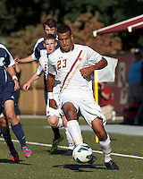 Boston College defender Stefan Carter (23) passes the ball. Boston College defeated University of Rhode Island, 4-2, at Newton Campus Field, September 25, 2012.