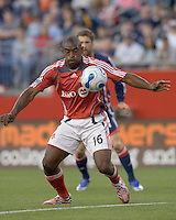 Marvell Wynne (Toronto, red) controls a Revolution cross. New England Revolution defeated Toronto FC, 3-0, at Gillette Stadium on June 23, 2007.