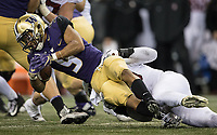 Myles Gaskin falls forward for another gain. Gaskin finished with 148 rushing yards.