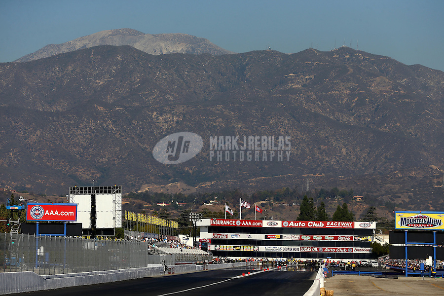 Nov 8, 2013; Pomona, CA, USA; Overall view of Auto Club Raceway at Pomona during NHRA qualifying for the Auto Club Finals. Mandatory Credit: Mark J. Rebilas-