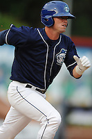 Asheville Tourists second baseman Brett Tanos #9 runs to first during a game against the Rome Braves at McCormick Field on August 18, 2011 in Asheville, North Carolina. Rome won the game 12-11.   (Tony Farlow/Four Seam Images)