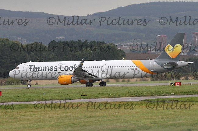 A Thomas Cook Airlines Airbus A321-211 Registered Number G-TCDD taxiing at Glasgow Airport on 9.10.15 bound for Tenerife South Airport.