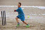 Matthew O'Shea keeps his eye on the ball during the beach cricket festival in Bettystown. Photo: Andy Spearman.