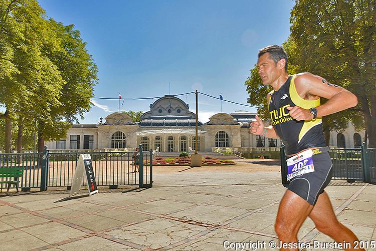 Competitor running past Napoleon III's Palais de Congrés, 2015.