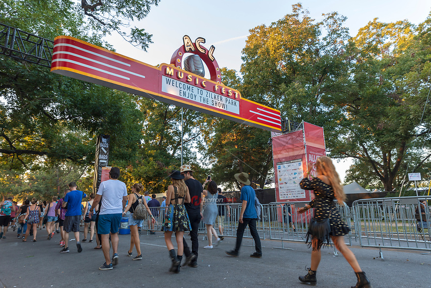 ACL Festival-goers flood through the entrance of the Austin City Limits Music Festival during the annual music festival held in Zilker Park in Austin, Texas on two consecutive three-day weekends.