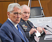 United States Secretary of Defense Chuck Hagel, left, and Chairman, Joint Chiefs of Staff General Martin E. Dempsey, U.S. Army, right, deliver testimony before the U.S. Senate Committee on Armed Services on the U.S. policy towards Iraq and Syria and the threat posed by the Islamic State of Iraq and the Levant (ISIL) in Washington, D.C. on Tuesday, September 16, 2014.<br /> Credit: Ron Sachs / CNP