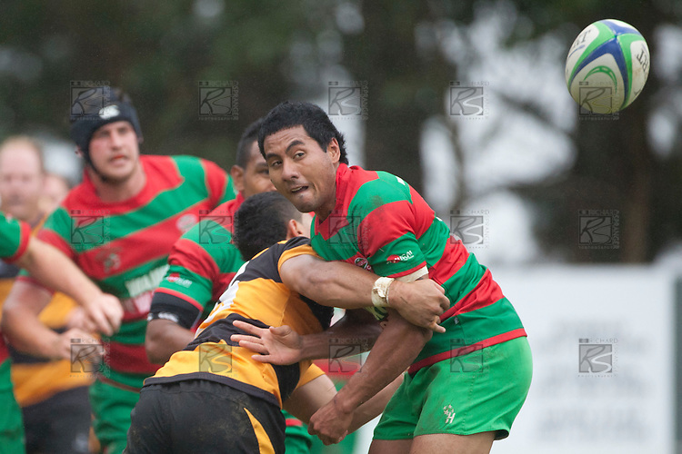 Ray Laulala gets the pass away as he is taken by Toni Pulu. Counties Manukau Premier Club Rugby game between Bombay and Waiuku played up on the hill at Bombay on March 26th 2011. Waiuku won 57 - 10 after leading 24 - 3 at halftime.