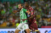 MEDELLIN - COLOMBIA, 29-09-2019: Hernan Barcos del Nacional disputa el balón con Julian Quiñones de Tolima durante partido por la fecha 13 de la Liga Águila II 2019 entre Atlético Nacional y Deportes Tolima jugado en el estadio Atanasio Girardot de la ciudad de Medellín. / Hernan Barcos of Nacional struggles the ball with Julian Quiñones of Tolima during match for the date 13 as part of Aguila League II 2019 between Atletico Nacional and Deportes Tolima played at Atanasio Girardot stadium in Medellín city. Photo: VizzorImage / Leon Monsalve / Cont