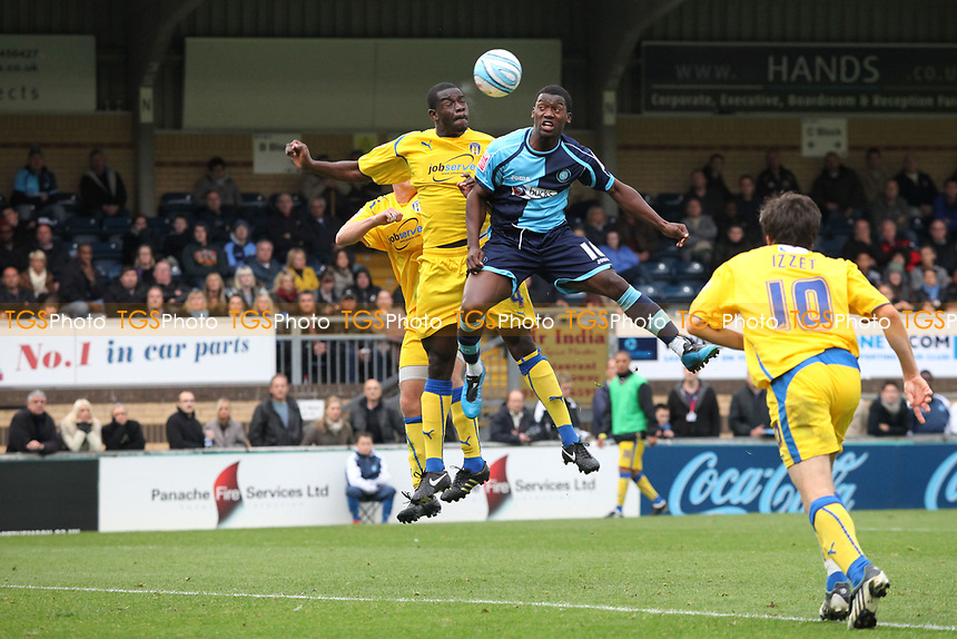 Wycombe's Jon Paul Pittman in an aerial challenge with Colchester's Magnus Okuonghae during Wycombe Wanderers vs Colchester United, Coca Cola League Division One Football at Adams Park on 17th October 2009