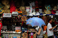 Aug. 6, 2008; Beijing, CHINA; A woman with an umbrella walks past a gift shop inside the Forbidden City in Beijing. The Olympics begin at 8pm on August 8, 2008. Mandatory Credit: Mark J. Rebilas-