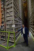 NWA Democrat-Gazette/ANDY SHUPE<br /> Marco De Prosperis, assistant dean of finance and administration at the University of Arkansas, explains Friday, June 29, 2018, the archival and catalog system in a storage facility south of Martin Luther King Jr. Boulevard in Fayetteville. The proper place for books in a space-starved library at the University of Arkansas, Fayetteville has become the subject of some debate after an email sent to faculty by an outgoing librarian urging them to fight against changes that are removing roughly two-thirds of printed materials.