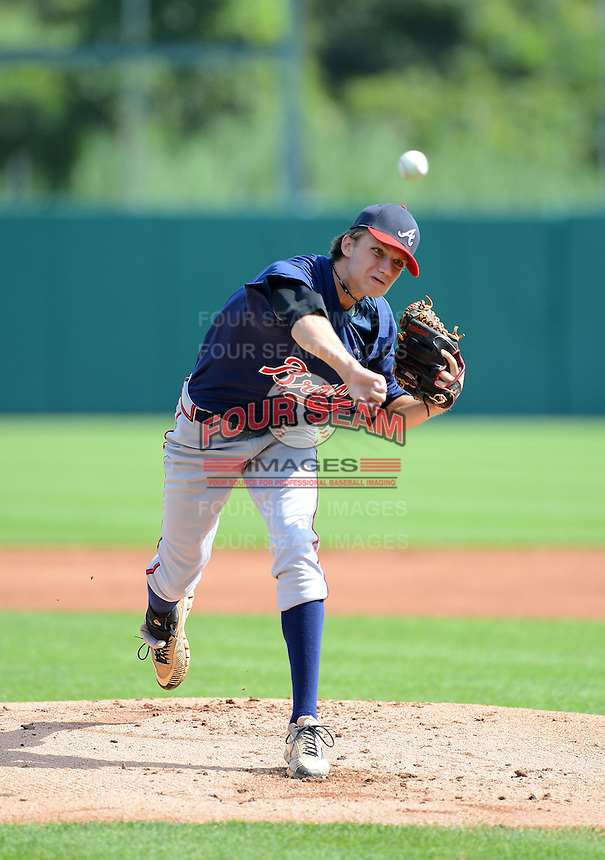 Pitcher Spencer Adams (27) of White County High School in Cleveland, Georgia playing for the Atlanta Braves scout team during the East Coast Pro Showcase on July 31, 2013 at NBT Bank Stadium in Syracuse, New York.  (Mike Janes/Four Seam Images)