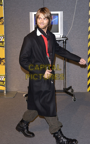 BRIAN -Brian McFADDEN<br /> MTV Europe Music Awards 2004<br /> November 18th, 2004<br /> full length, black coat, black boots, tight ankles, fashion didsaster<br /> www.capitalpictures.com<br /> sales@capitalpictures.com<br /> &copy;Capital Pictures