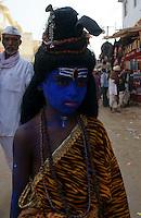 boy made up as god shiva in the streets of  holy city Pushkar, Rajastan, India