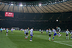 The home team go in search of a goal as Hertha Berlin (blue) take on Sporting Lisbon in the Olympic Stadium in Berlin in a UEFA Europa League group match. Hertha won the match by 1 goal to nil to press to the knock-out round of the cup. 2009/10 was the the first year in which the Europa League replaced the UEFA Cup in European football competition.