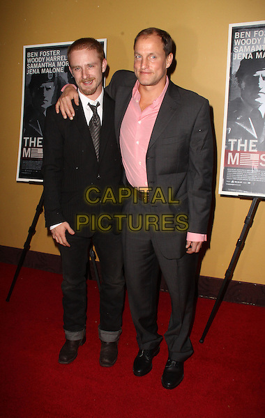 "BEN FOSTER & WOODY HARRELSON.Premiere of ""The Messenger"" at Clearview Chelsea Cinemas, New York, NY, USA, .8th November 2009..full length grey gray suit pink shirt black tie arm around shoulder turned up .CAP/ADM/PZ.©Paul Zimmerman/AdMedia/Capital Pictures."
