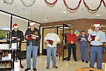 Merrick Post #1282 of American Legion members play music and sing holiday songs for veterans at Northport VA Medical Center on December 10, 2011, in Northport, New York, USA. Booker T. Gibson (Merrick) plays piano while veterans sing Christmas songs.