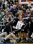 Butler players, including Matt Howard, center left, and Andrew Smith, center right, celebrate their 63-56 win over Kansas State in the NCAA West Regional final college basketball game in Salt Lake City, Saturday, March 27, 2010. (AP Photo/Paul Sakuma)