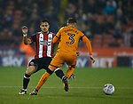 George Baldock of Sheffield Utd and Barry Douglas of Wolverhampton Wanderers during the Championship match at the Bramall Lane Stadium, Sheffield. Picture date 27th September 2017. Picture credit should read: Simon Bellis/Sportimage
