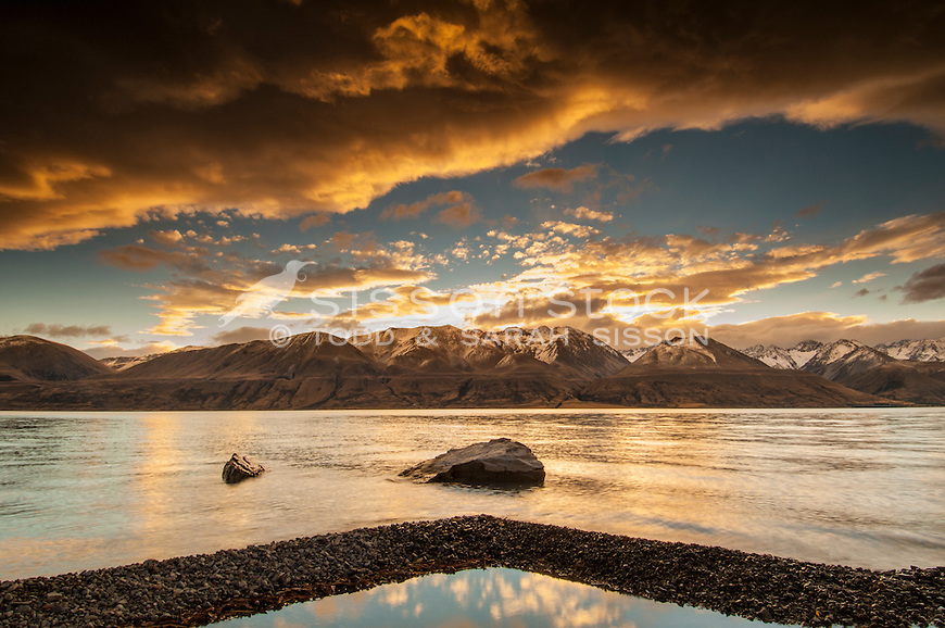 Sunset clouds over Lake Pukaki from the eastern shores of the lake, Mackenzie Country, South Island,  New Zealand.