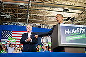 United States President Barack Obama delivers remarks at a campaign event for Terry McAuliffe, left, at Washington-Lee High School, Arlington, Virginia, U.S., on Sunday, November 3, 2013. McAuliffe is the Democratic nominee in the 2013 Virginia gubernatorial election. <br /> Credit: Pete Marovich / Pool via CNP