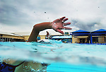 Natalie Burton <cq>, 17 and a junior, swims Wednesday, October 12, 2005, during a DeLand High School swim practice at the DeLand YMCA in DeLand. (Daytona Beach News-Journal, Chad Pilster)