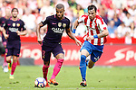Sporting de Gijon's Fernando Amorebieta (r) and FC Barcelona's Rafinha Alcantara during La Liga match. September 24,2016. (ALTERPHOTOS/Acero)