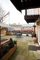 A gazebo complete with flagpole and a wrought iron garden table and chairs are situated on the spacious canalside terrace leading to the entrance