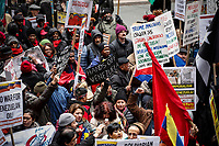 NEW YORK, NY - FEBRUARY 23: People attend a Pro-Venezuelan Government protest and against the US military intervention in latin america on February 23, 2019 in Wall street New York.  (Photo by Kena Betancur/VIEWpress)