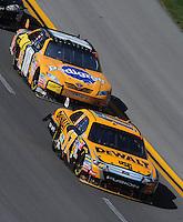 Apr 26, 2009; Talladega, AL, USA; NASCAR Sprint Cup Series driver Matt Kenseth (17) leads Kyle Busch (18) during the Aarons 499 at Talladega Superspeedway. Mandatory Credit: Mark J. Rebilas-