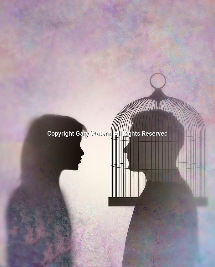 Couple looking at each other with man's head trapped in bird cage