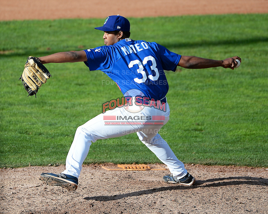 Ogden Raptors relief pitcher Jackson Mateo (33) delivers a pitch to the plate against the Grand Junction Rockies in Pioneer League play at Lindquist Field on September 8, 2013 in Ogden Utah.  (Stephen Smith/Four Seam Images)