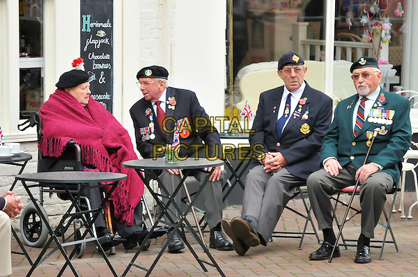 Atmosphere .HM THE QUEEN, Elizabeth II (2nd) & HRH PRINCE PHILIP, Duke of Edinburgh Royal Visit to Margate, Kent, England..November 11th, 2011.royals royalty sitting soldiers uniform poppy hat full length pink blanket green black grey gray.CAP/CAS.©Bob Cass/Capital Pictures.