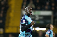 Adebayo Akinfenwa of Wycombe Wanderers celebrates the second goal during the Sky Bet League 2 match between Notts County and Wycombe Wanderers at Meadow Lane, Nottingham, England on 10 December 2016. Photo by Andy Rowland.