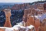 Bryce Canyon National Park, Utah; views of The Hunter, a hoodoo with small trees atop, with snow in winter, Agua Canyon, elevation 8800 feet