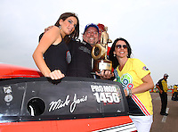 Apr 27, 2014; Baytown, TX, USA; NHRA pro mod driver Mike Janis celebrates after winning the Spring Nationals at Royal Purple Raceway. Mandatory Credit: Mark J. Rebilas-