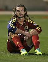 Kyle Beckerman #5 of Real Salt Lake watches D.C. United players celebrate their win over Real at the U.S. Open Cup Final on October  1, 2013 at Rio Tinto Stadium in Sandy, Utah. DC United beat Real Salt Lake 1-0 to win the championship.