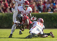 Hawgs Illustrated/BEN GOFF <br /> De'Jon Harris (8), Arkansas linebacker, and defensive back Kevin Richardson (30) tackle South Carolina tight end K.C. Crosby in the first quarter Saturday, Oct. 7, 2017, during the game at Williams-Brice Stadium in Columbia, S.C.