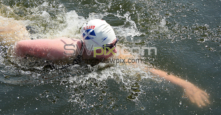 PICTURE BY VAUGHN RIDLEY/SWPIX.COM -  Swimming - Festival of Open Water Swimming - London Regatta Centre, Royal Albert Docks - London, England - 24-25/06/06...? Simon Wilkinson - 07811 267706...Jo-Ann McGarvey of Ren 96 reaches for the finish of the LEN Open Water Cup/British Open Water Championship Race.