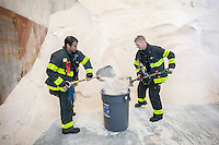 Firefighters stop by to pick up a supply of salt in advance of this weekends winter snowstorm at the New York City Dept. of Sanitation Salt Shed Thursday, January 21, 2016. The city is expecting blizzard conditions with gale force winds with up to 12 inches of snow starting Saturday in Sunday.   (© Richard B. Levine)