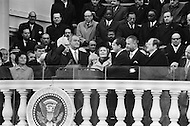20 Jan 1969, Washington, DC, USA. Chief Justice Earl Warren swears in Richard Milhous Nixon as the 37th President of the United States on the steps of the US Capitol. Also present during the ceremony is Pat Nixon and previous president, Lyndon B. Johnson.