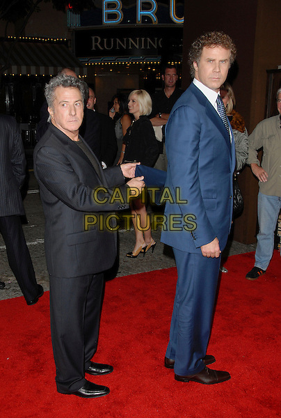 "DUSTIN HOFFMAN & WILL FERRELL.The Columbia Pictures' World Premiere of ""Stranger than Fiction"" held at The Mann Village Theatre in Westwood, California on October 30, 2006.Copyright 2006 Debbie VanStory.Ref: DVS.full length black blue suit funny grabbing jacket .www.capitalpictures.com.sales@capitalpictures.com.©Debbie VanStory/Capital Pictures"