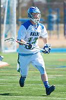 Ross Burr,'16, works defense as the Seahawks battle Endicott in Men's Lacrosse game action at Gaudet Field in Middletown.