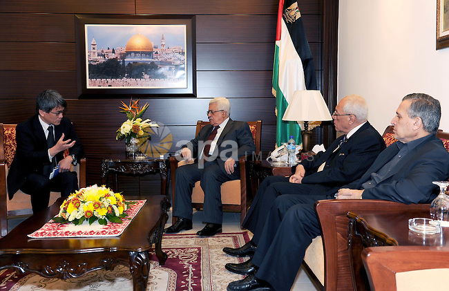 Palestinian  President Mahmoud Abbas (Abu Mazen) meets  with the Japanese Ambassador in Ramallah in west bank March14,2011 Photo by Thaer Ganaim