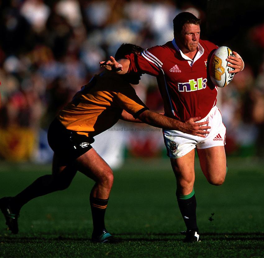 Photo. Richard Lane. .Lions Tour 2001 to Australia. Match 6 NEW Country Cockatoos v Lions at the International Stadium, NSW, Australia. 26-6-2001.Scott Gibbs attacks.