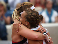 Paris, France, 26 June, 2016, Tennis, Roland Garros,  Doubles: Michaella Krajicek (NED) (R) with her doubles partner Barbora Strycova embrace after defeating Errani/Arruarrenaem<br /> Photo: Henk Koster/tennisimages.com