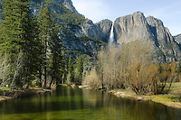 Distant view of Upper Yosemite Falls and the Merced River reflections on the valley floor below